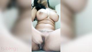 Breasty girl fingering her bushy cookie hard on livecam