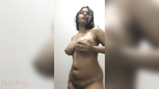 Busty girl in nature's garb dance in the bath MMS