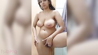 Breasty Indian Bhabhi selfie stripped MMS video