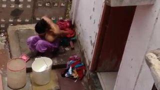 Big tits desi bhabhi shower video filmed by neighbor in open
