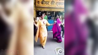 Stunning Indian aunty XXX strip dances around with one of her tits out