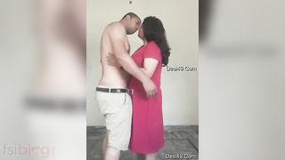 Pleasant Desi MILF in pink dress kneels to suck man's XXX truncheon